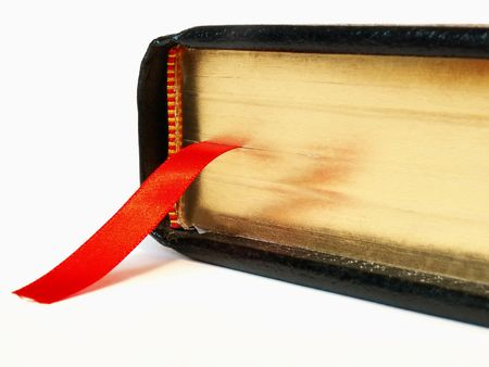 Black Bible closed with red ribbon bookmark