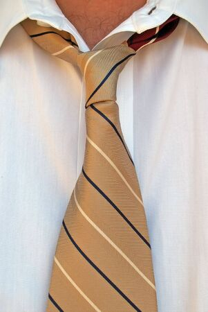 business man with loosened tie photo