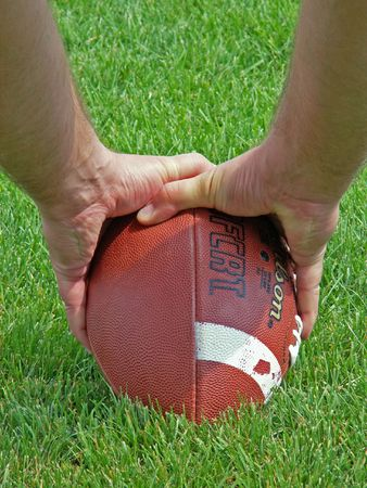 punt: hands on a football