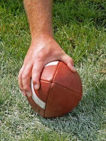 punt: hand on a football