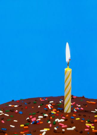 chocolate birthday cake with sprinkles and a candle Stock Photo - 357668