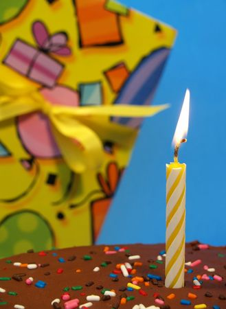birthday cake with candle in front of a birthday gift Stock Photo - 357669