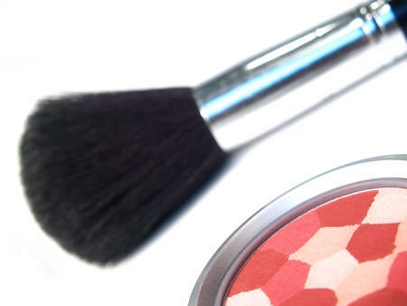 multi-colored blush with brush in background