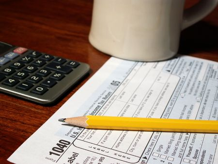 financial official: working on 1040 income tax form