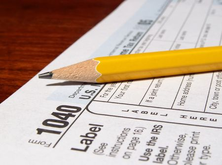 pencil and 1040 income tax form