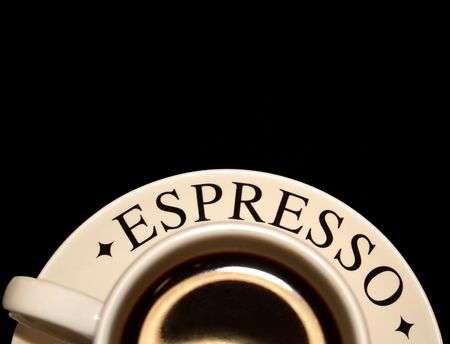 cup of espresso at the bottom edge
