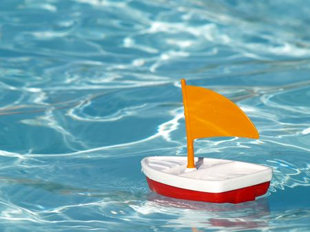 toy sailboat in a swimming pool Stock Photo