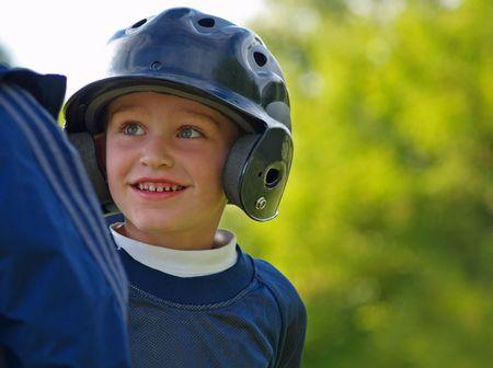 baseball boy interacting with base coach