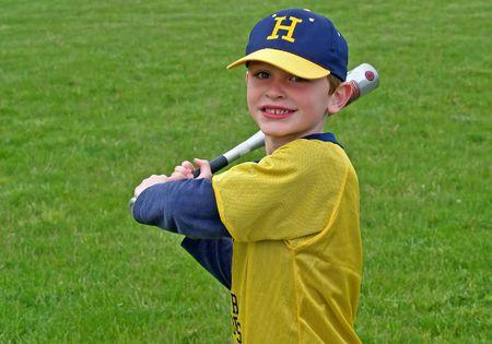 young boy playing baseball or t-ball