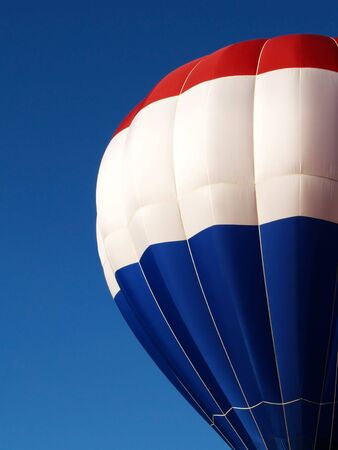 red, white and blue hot air balloon canopy