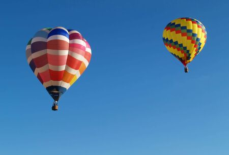 two colorful hot air balloons in flight Stock Photo