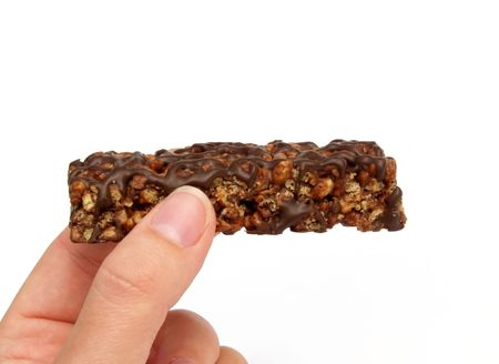 holding a chocolate protein bar