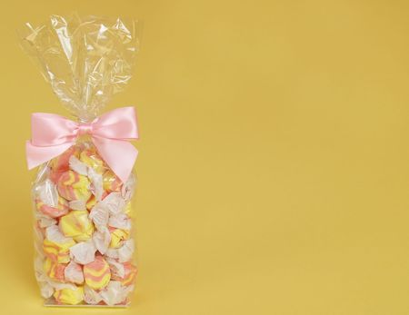 taffy: pink and yellow salt water taffy tied with a pink bow