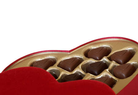 heart-shaped chocolates in a red heart-shaped box