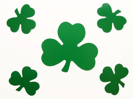 five green paper shamrocks arranged over white Stock Photo - 779111