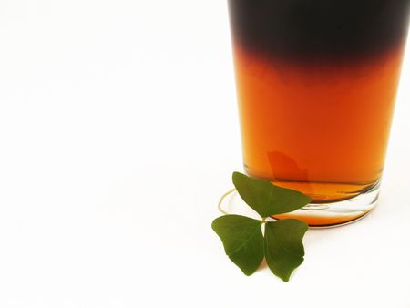 Black and tan beer in a pint glass with a shamrock