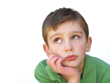 boy resting his face on his hand Stock Photo