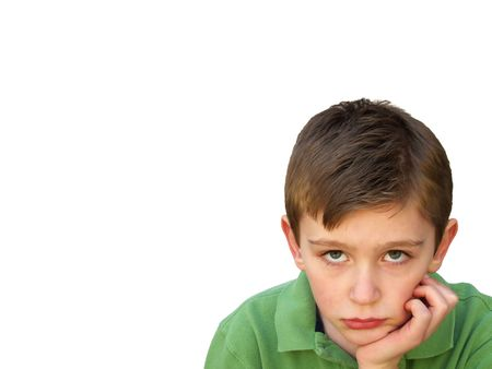 bored boy with chin resting on hand Stock Photo