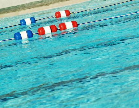 roped off: swimming pool with swim lanes roped off