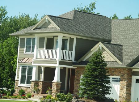 a newer house with summer landscaping