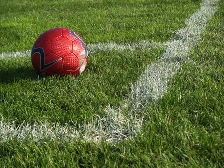 フィールドの隅にサッカー ボール 写真素材