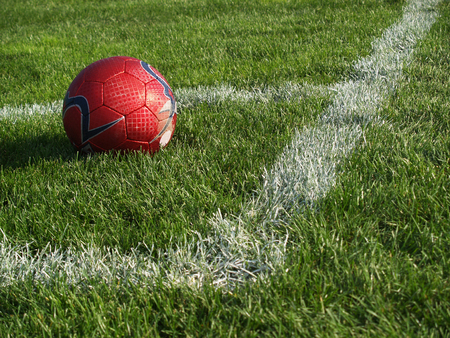 soccer ball in the corner of the field photo