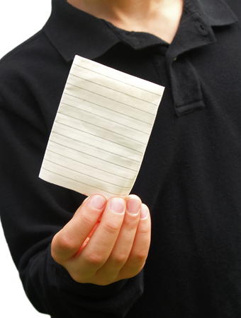 boy passing a folded note written on lined notebook paper