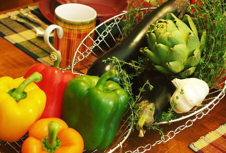 fresh vegetables and herbs as a centerpiece on a table