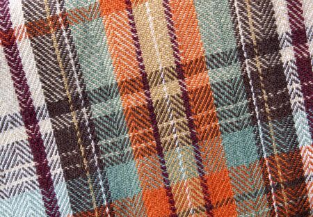 a swatch of fall - orange and brown - plaid cloth