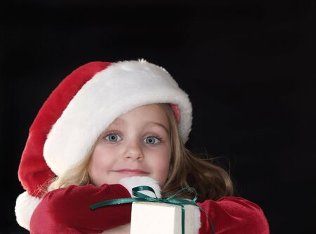 little girl in Santa dress and hat for Christmas