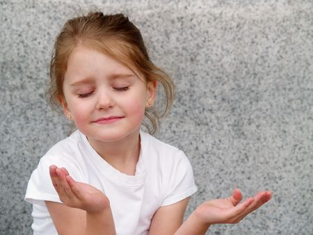 little girl with upturned hands as in prayer or meditation photo