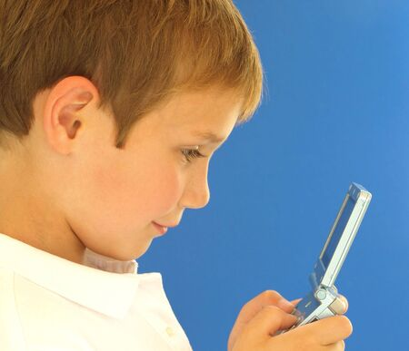 young boy playing a handheld video game