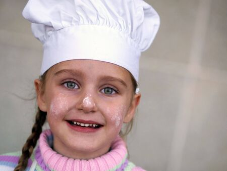 a young girl wearing a chef's hat photo