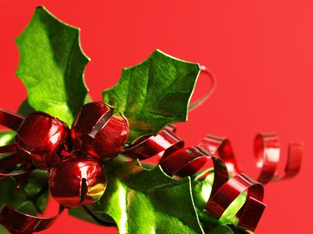 A Metal Christmas Wreath With Green Leaves, Red Ribbons And Bells ...