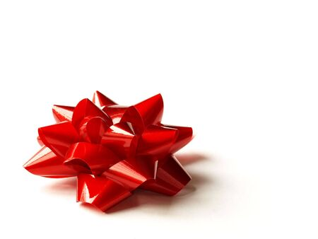 a single red bow for a Christmas or Valentines Day gift