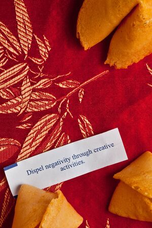 dispel: Fortune cookies on red silk: dispel negativity through creativity Stock Photo