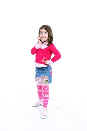 skirt up: Cute little girl with her hand on her hip, holding a cell phone and rolling her eyes.