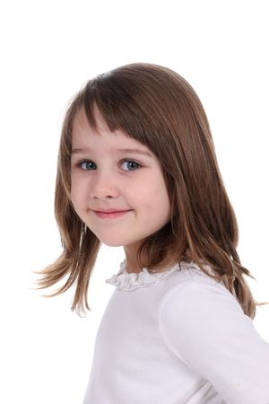 Pretty brown haired little girl against a white background. photo