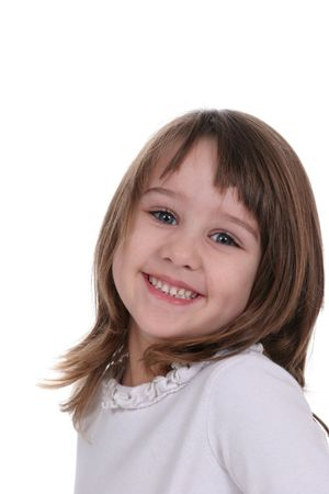 Pretty Smiling little girl with her head tilted to one shoulder; against a white background. photo