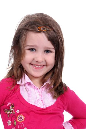 Cute little girl in pink top, with a twinkle in her eye and her hand on her hip; against a white background. photo