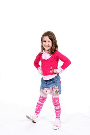 Stylish little girl in pink striped tights and a patterened short denim skirt.