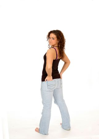 Teenage girl with her hands in pockets against white background. Stock Photo - 3026680