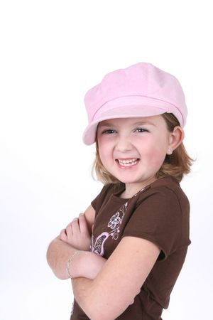 Cute little girl in pink hat with her arms crossed. Stock Photo