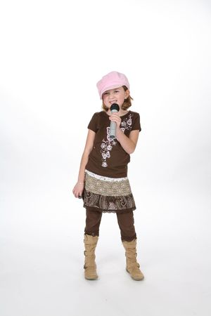 Stylish girl using a microphone against a high key background.