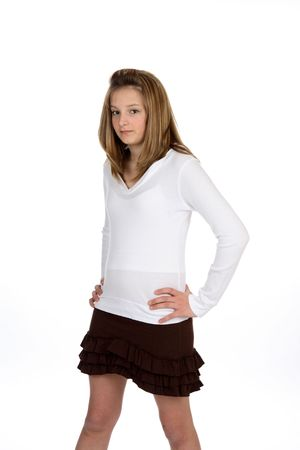 Cute girl in brown ruffled mini skirt.
