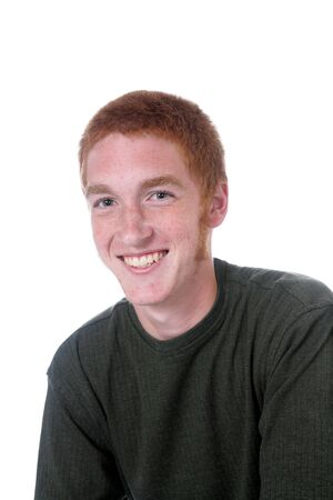 sideburns: Attractive red haired boy with sideburns and a nice smile.