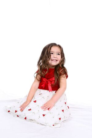 Beautiful toddler in a red and white holiday dress Stock Photo - 3150776