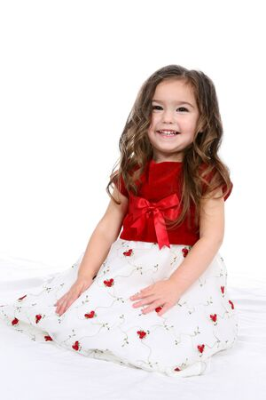 Pretty little girl in red and white christmas or valentines day dress.