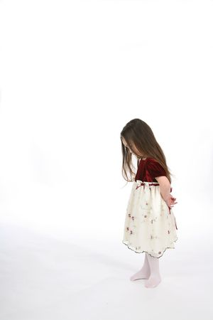 velvet dress: Little girl with head down and hands behind her back.