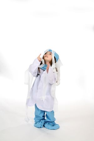 Young doctor girl in scrubs tangled up in gauze. photo
